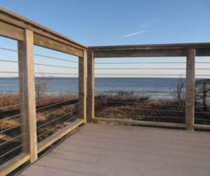 Site built cable railing systems can use wood posts and steel components.