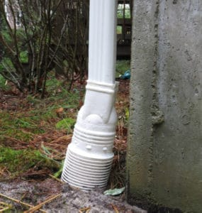 Downspout adapted connects downspout to burried 4-in PVC drain line.